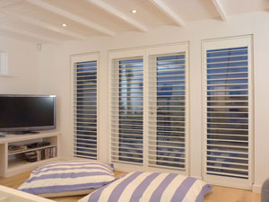 Full height interior window shutters