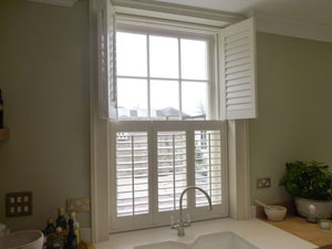 See how window shutters are folded open