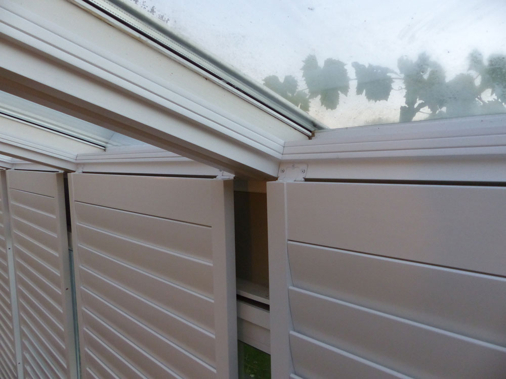 Conservatory shutter panels hinged downwards