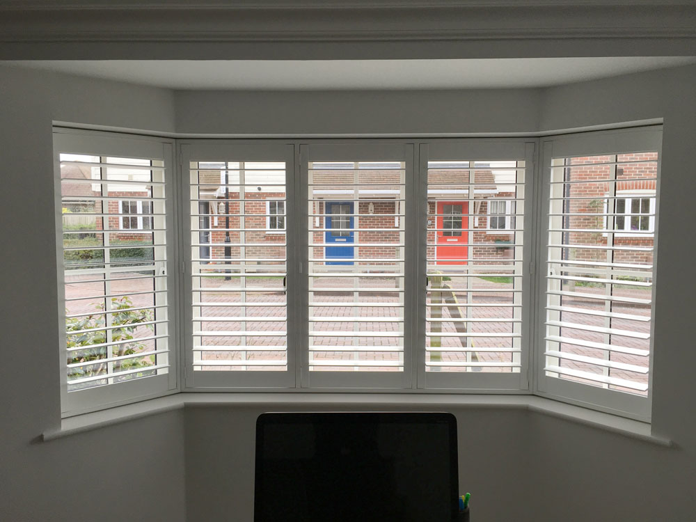 White Plantation Shutters Fitted to Angled Bay Window in Lounge