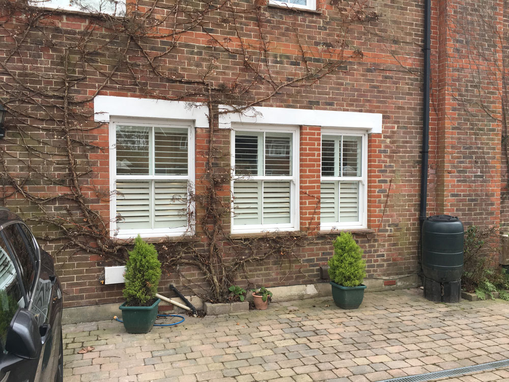 Wooden Exterior Shutters. Three Windows With Shutters From Outside The House