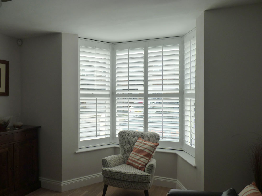 Small Angled Bay Window with White Shutters Fitted