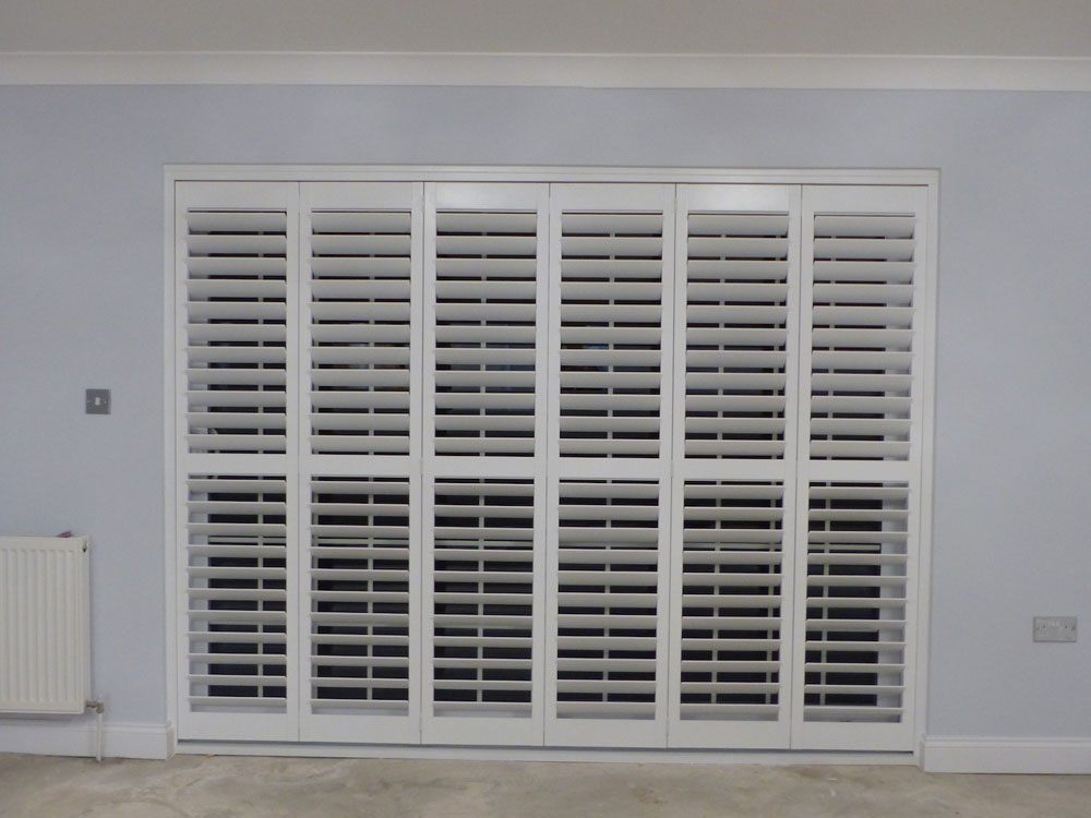 Tracked Shutters Across Patio Doors