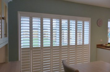 Track mounted shutters for wide openings