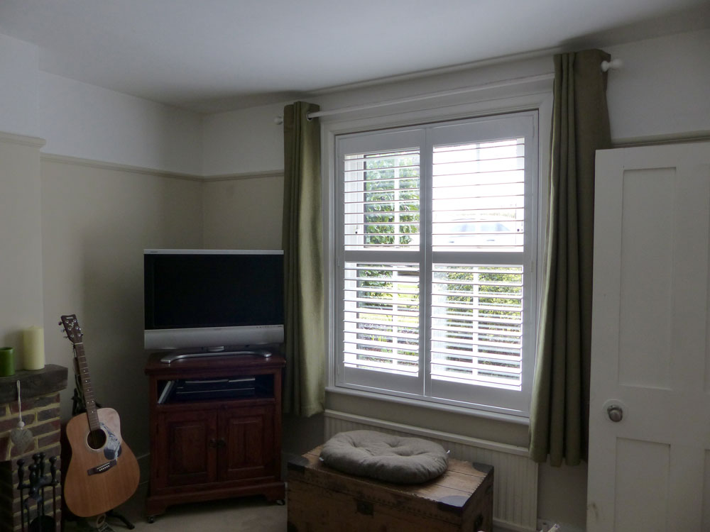 Shutters Fitted To Square Window in Living Room
