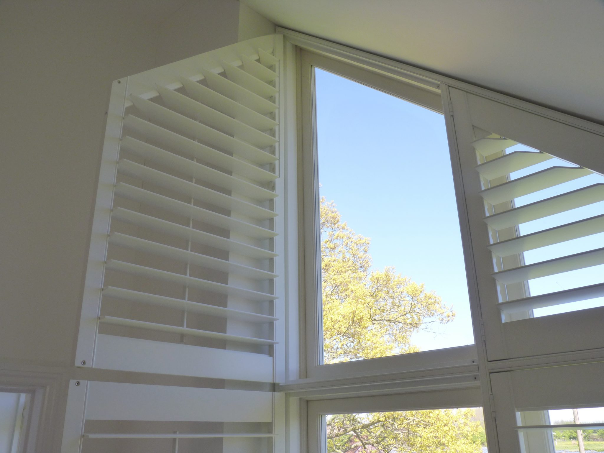 Custom Made Plantation Shutters Fitted to Shaped Window