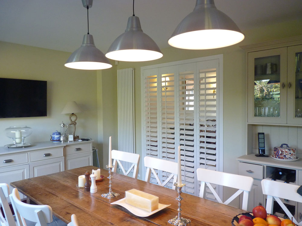 Shutters Fitted as a Room Divider Between Kitchen and Living Room
