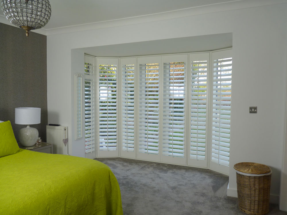 Plantation Shutters Fitted onto Large Round Bay Doors in Bedroom