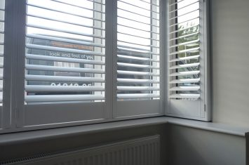 Interior plantation shutters weather protection