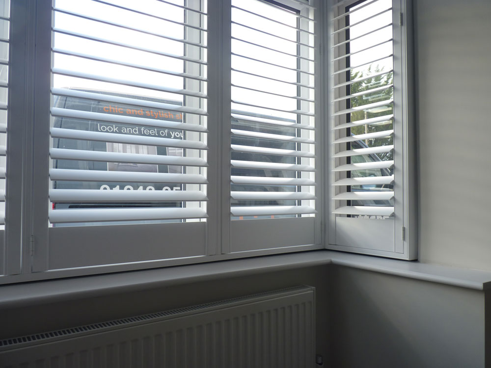 Interior plantation shutters weather protection opennshut Plantation window shutters interior