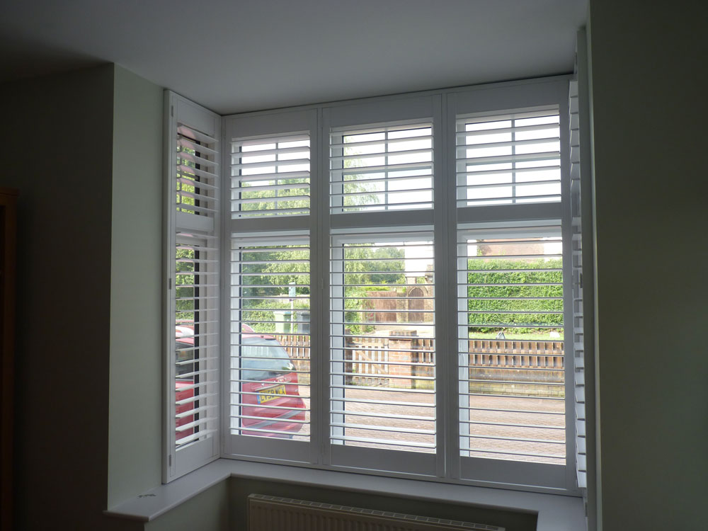 Small Bay Window with White Shutters Fitted