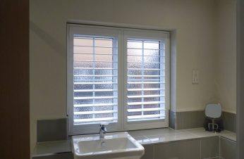 White Shutters in Bathroom Window