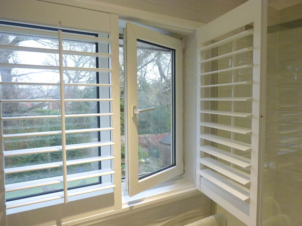 Inward opening window with shutters